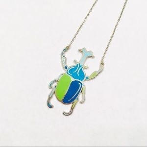 Unicorn Beetle enamel necklace by Onch movement